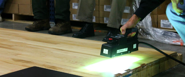 Using an ultraviolet curing system on a hardwood floor