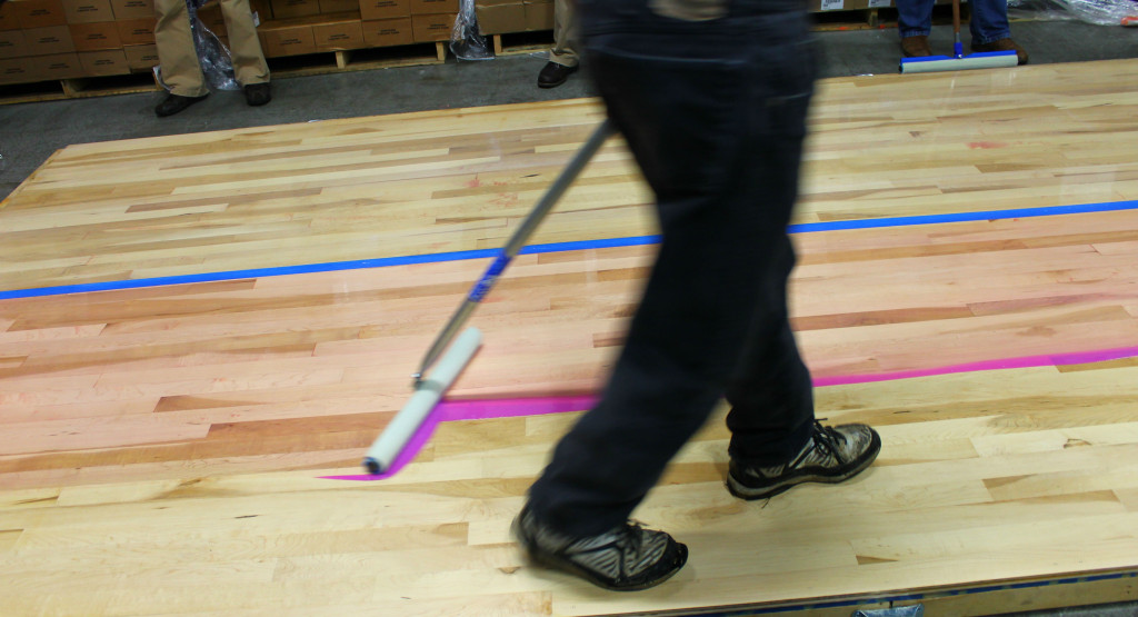 Applying a water-based UV cure finish to a hardwood floor