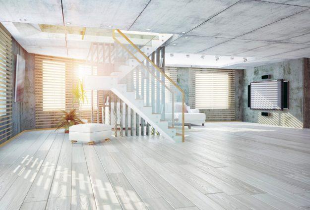 Graywashed wide plank ash hardwood floor