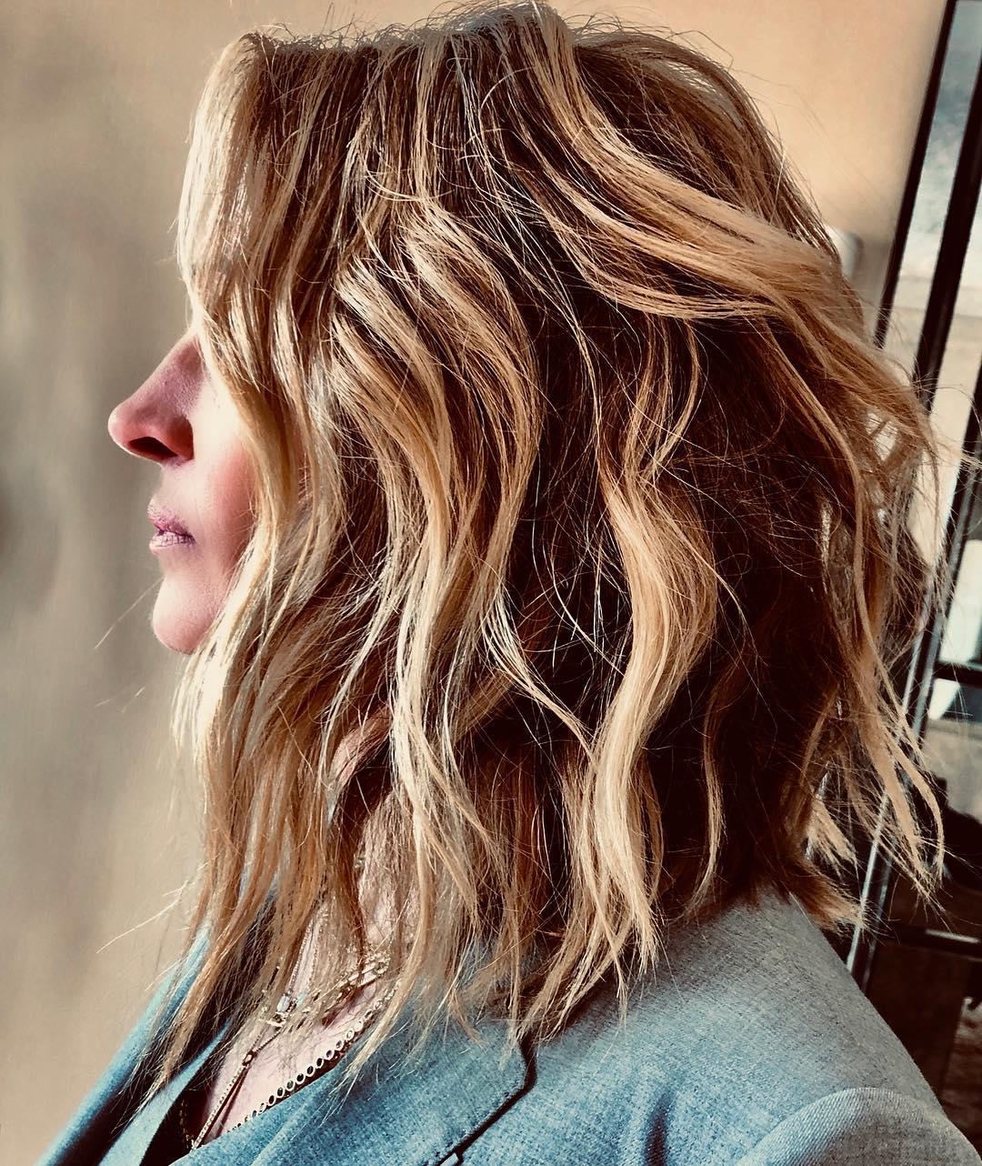 Taglio capelli donna scalati