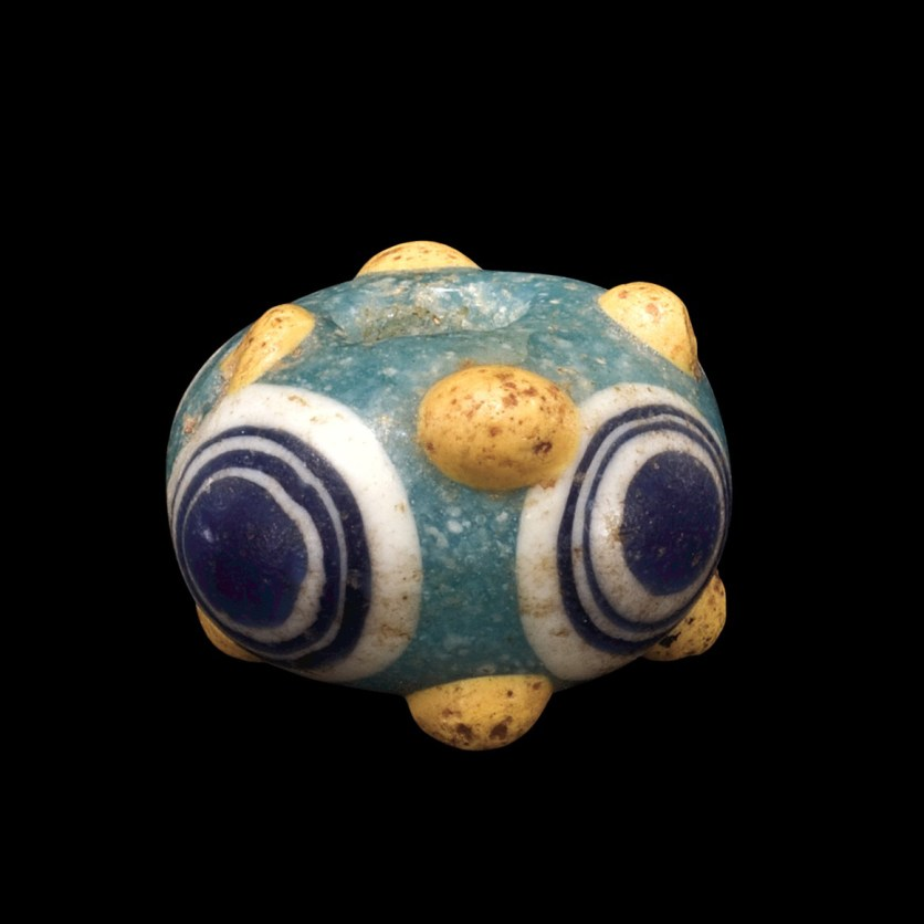 Composite Eye Bead, core-formed, trailed. Possibly Carthage (in modern Tunisia), possibly Eastern Mediterranean, 600-250 BC. Diam (max): 1.2 cm, Th: 0.8 cm. (54.1.143-3)