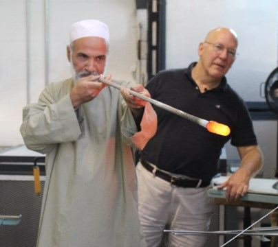 Mr. Nasrullah works with Bill Gudenrath to create glass.