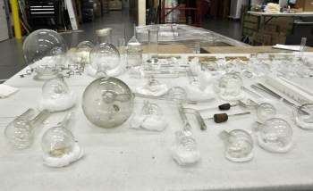 Stubborn stains and long, narrow shapes that limit access to the inside make the museum's collection of historic scientific lab ware difficult to clean.