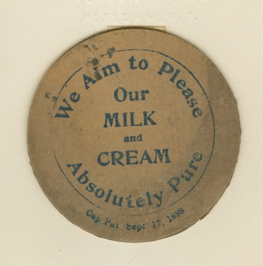Paper milk bottle cap, sent to Samuel E. O'Connell from Fred J. Hayes.