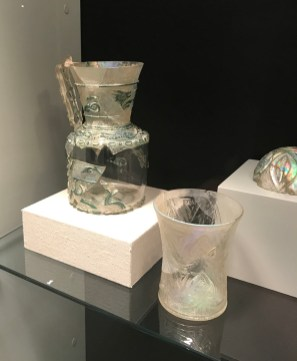Close up of the pitcher in its case in the Glass in the Islamic World Gallery.