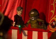 I give up.  What the hell is the green thing?  My best guess is the worst Alpha Centauri ever, but he/she didn't have hair.  Or a necklace, or basically anything I see here other than green skin and one eye. (c)BBC