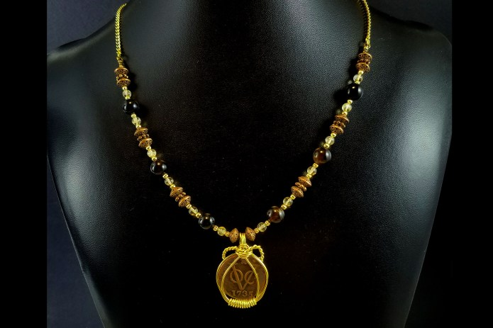 New York Penny on strand of necklace beads