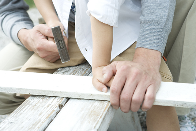Hands of father and son doing DIY