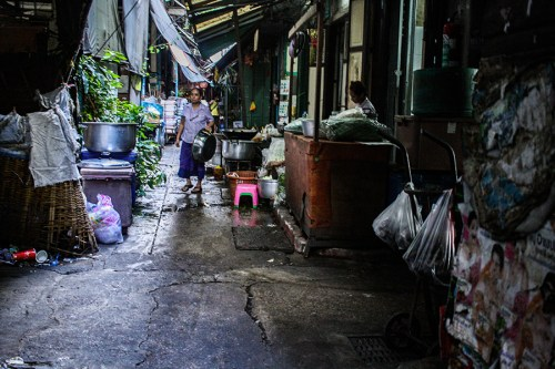 A woman holds a pot in alley, Dec. 4, 2015 in Bangkok, Thailand. I really like alleys.