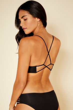 Woman wearing travel bralette with strappy back.