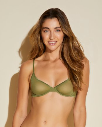 Woman wearing a molded bra with underwire cups.