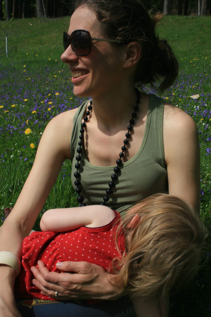 Nursing a baby with the Milk Daze nursing necklace