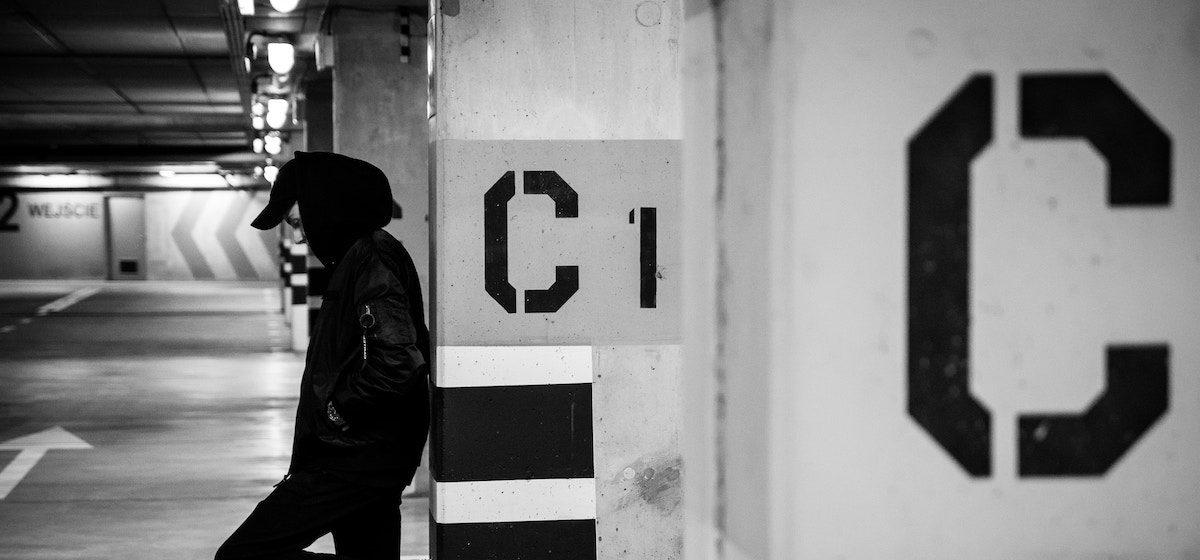 "Photo of parking-garage pillar stenciled ""C"". Photo by Dawid Zawiła, from Unsplash"