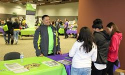 CPTC Entry Services Specialist Kiko Salas speaks with visitors at CPTC's Program Expo on Wednesday, April 11, at the McGavick Conference Center.