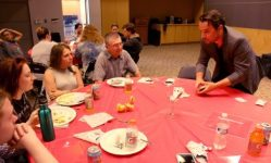 Magician Nate Jester spent the first half of his performance performing tricks to individual table audiences.