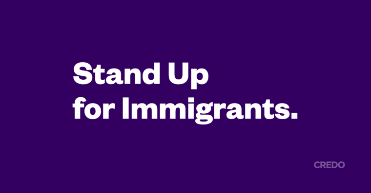 """The statement """"Stand Up for Immigrants."""" in white letters on an indigo background"""