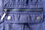 Zippered Pocket above a pocket flap