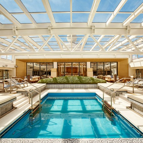 The Main Pool area onboard with the retractable roof closed.