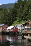 The reflections of historic Creek Street houses in Ketchikan Alaska.