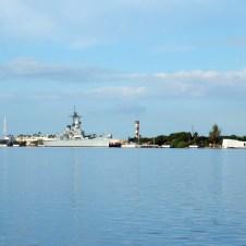 Arizona and Missouri Memorials scene across Pearl Harbor on the island of Oahu in Hawaii.