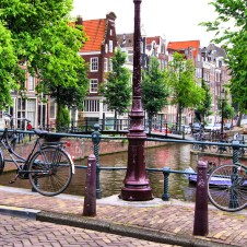 Bikes chained along canals in Amsterdam
