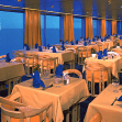 The sophisticated main dining room on Holland America ships