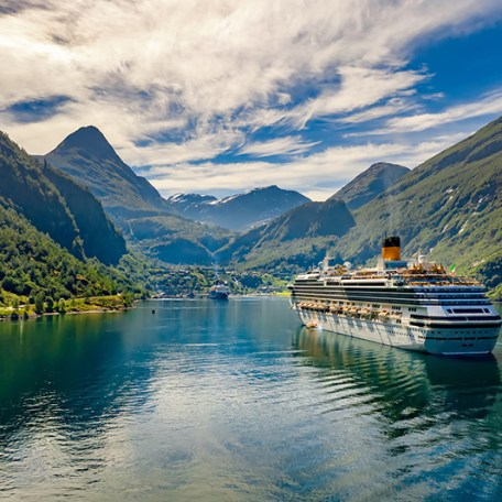 A summer Norwegian Fjords cruise - ship in Geiranger fjord, Norway.