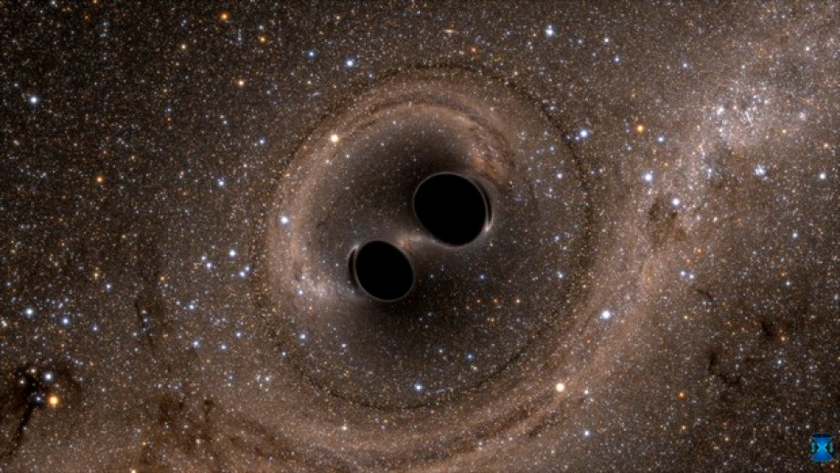 A shot from a computer simulation shows two black holes spiralling towards each other, eventually colliding and merging into one. The gravitational waves caused by the event have been detected by LIGO with the help of CSIRO and a number of Australian universities. Image credit: LIGO, SXS