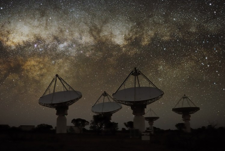 Night time view of dishes that are part of the Australian Square Kilometre Array Pathfinder (ASKAP) - a next-generation radio telescope in remote Western Australia