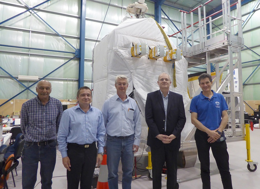 Scientists standing in front of PILOT payload