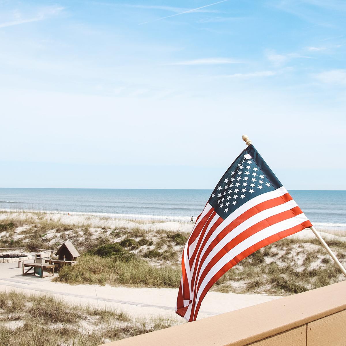 Flag waving of desk on beach