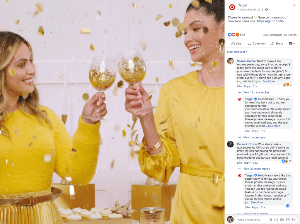 Two ladies dressed in yellow cheering with two champagne glasses