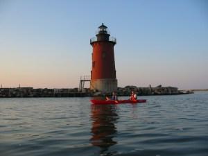 Kayak au coucher de soleil dans la Baie du Delaware