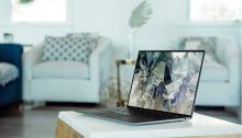 a livingroom background with a windows laptop on the coffee table