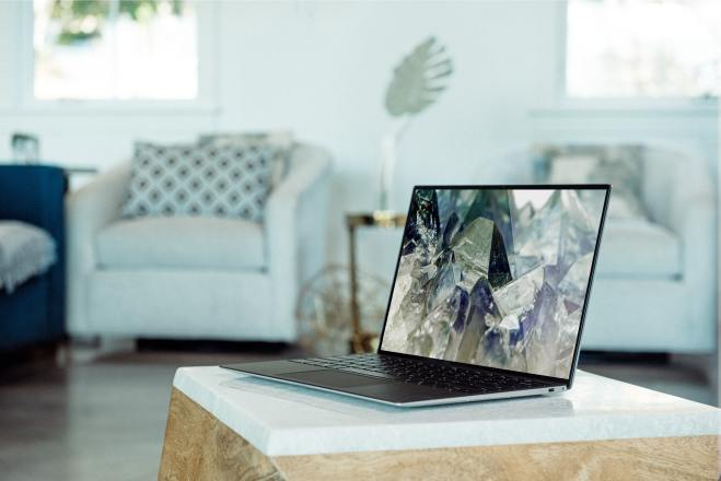 a living room background with a windows laptop on the coffee table
