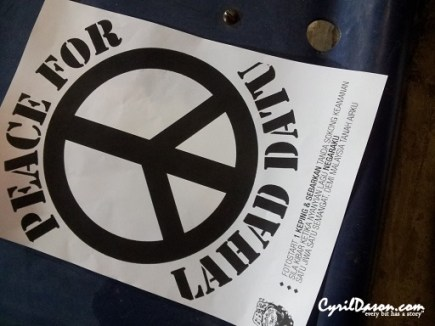 A4 papers saying 'Peace for Lahad Datu' distributed