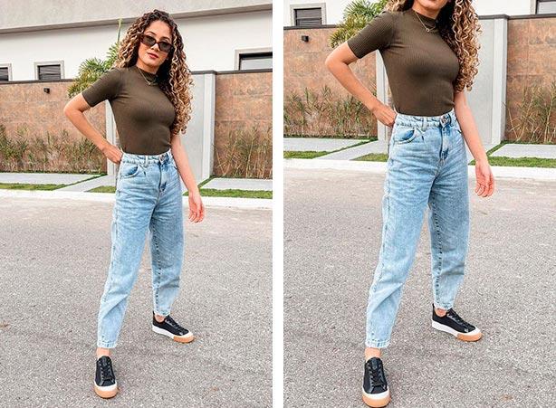 Calça jeans clara com blusa escura e tênis preto