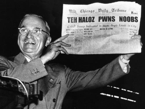 "Harry Truman holds newspaper with headline ""Teh Haloz Pwns Noobs"""