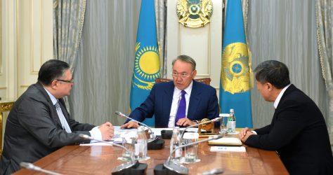 From left to right: Marat Tazhin, Nursultan Nazarbayev, and Adilbek Dzhaksybekov.