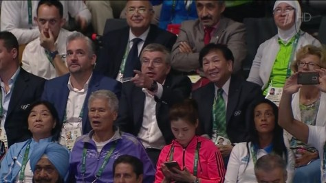Dr. Thomas Bach, in the center, points his finger at someone after the final boxing bout in the 91 kg. weight category at the Rio 2016 Olympics, August 15, 2016.