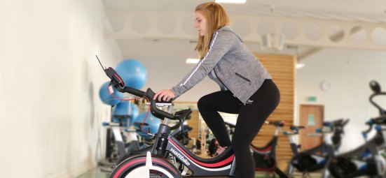 Image of PT using a Wattbike from side angle