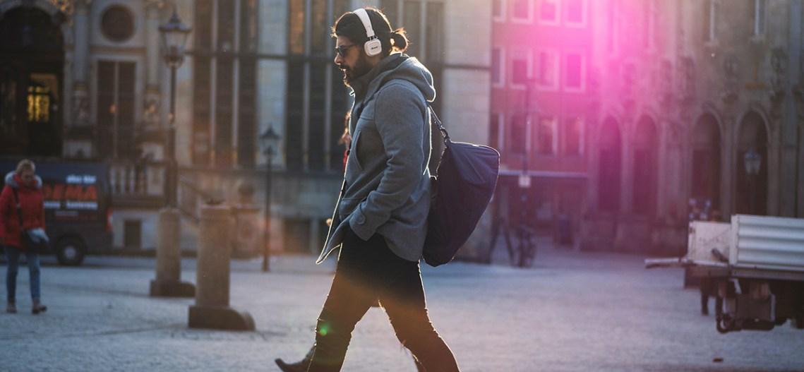 man-walking-listening-to-music