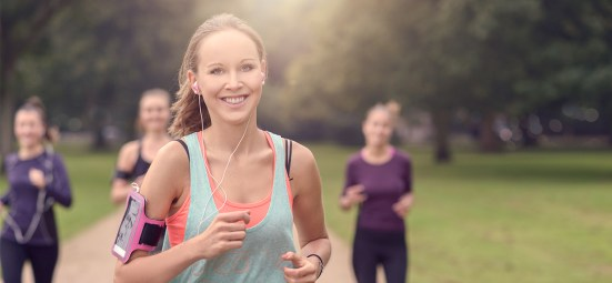 woman-running-in-group-listening-to-music