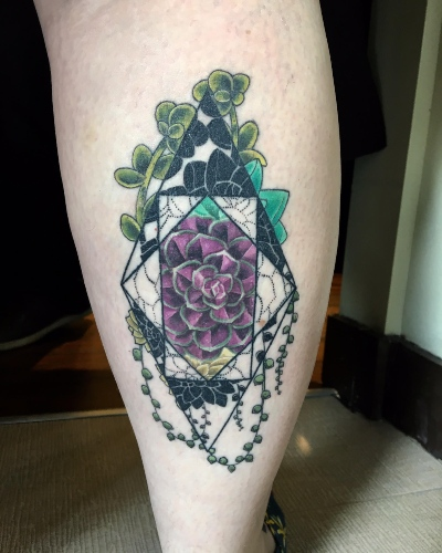 a geometric tattoo by Birdie with a flower and other plants