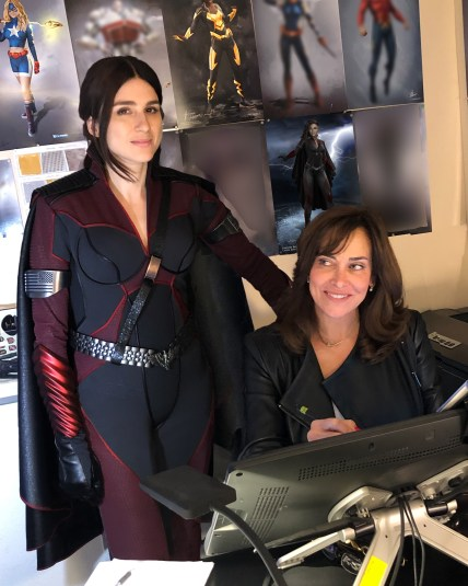 the Stormfront actress in her costume standing by Gina