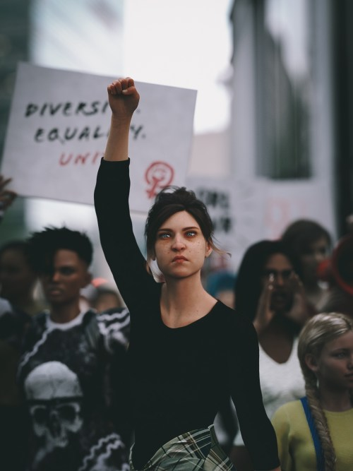 a woman in a crowd with her fist raised in the air