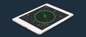 On the screen of a tablet an illustration of a map centers around a locator point. A green circle surrounds the locator point geotargeting the distance from the locator point to every household and business located within a specific radius.