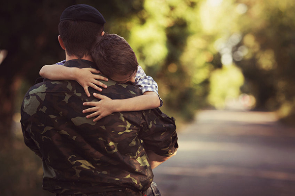 38555979 - boy and soldier in a military uniform say goodbye before a separation