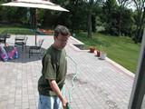 Me washing the patio