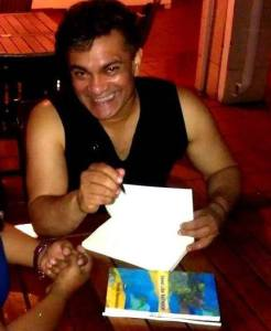 Signing books for J. in Guyana